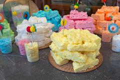 Yellow and multicolor meringue cakes in pile Stock Photos