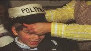 Stock Video Footage of Vintage 8 mm film: Boy playing police man, 1970s
