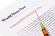 Outbreak swine flu newspaper headline with syringe Stock Photos