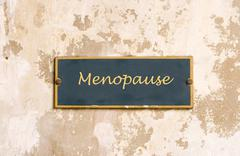 menopause on weathered wall - stock photo