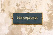 Menopause on weathered wall Stock Photos