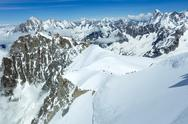 Stock Photo of mont blanc mountain massif and  unrecognizable alpinists groups
