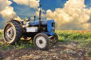 Stock Photo of very old tractor in field, different parts - no trademark at all