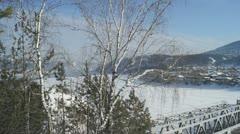 Bridge Over Siberian River Mana (pan right) Stock Footage