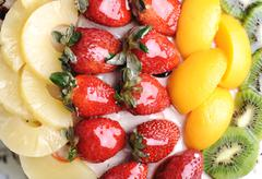 Beautiful yummy fruit cake: strawberry, kiwi, mango, bananas and chocolate Stock Photos
