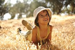 Careless boy on yellow grass meadow in autumn Stock Photos