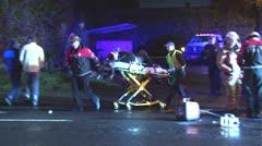 Medics load victim into ambulance - stock footage