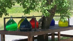 colored bottles perfume essence along the Route Napoleon - stock footage