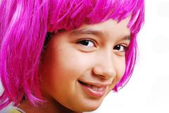 adorable girl with pink hair - stock photo