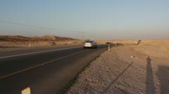 Car pass the desert Stock Footage