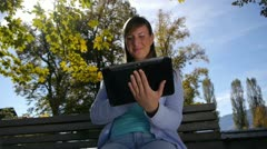 DOLLY: Young woman using digital tablet Stock Footage