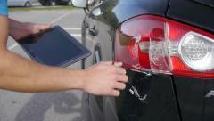 Sketching car damage on digital tablet - stock footage