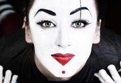 Beautiful woman mime with green eyes Stock Photos