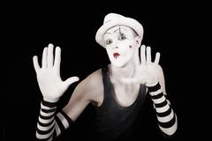 mime in striped gloves and white hat - stock photo