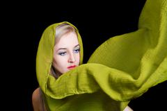Beautiful young woman in green summer shawl Stock Photos
