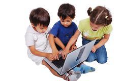 Chidren activities on laptop Stock Photos
