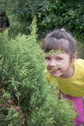 Little girl playing in hide-and-seek Stock Photos
