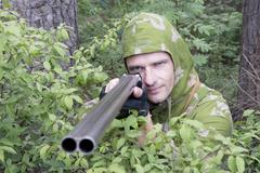 the shooter in camouflage - stock photo