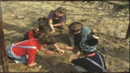 Stock Video Footage of Vintage 8 mm film: Children playing in sandpit, 1960s