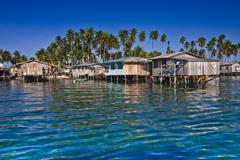Sea gypsy village on wooden stilts Stock Photos
