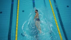 AERIAL: professional swimmer - stock footage