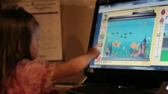 Child playing on the computer Stock Footage