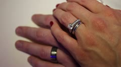 Handheld shot of just married couples hands with rings - stock footage