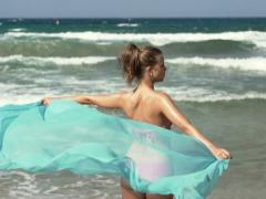 Sexy woman with pareo on beach, super slow motion, shot at 240fps NTSC - stock footage