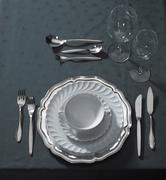 Noble place setting on dark tablecloth Stock Photos