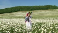 Child among flowers. Slow motion Stock Footage