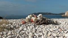 Net on pebble beach zoom in Stock Footage