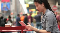 Woman Using Tablet in Timesquare - Profile Shot Stock Footage