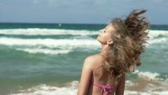 Woman with beautiful hair by the sea, super slow motion, shot at 240fps HD Stock Footage
