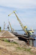 powered floating crane - stock photo
