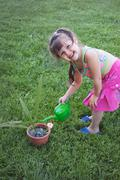Little girl watering the plants Stock Photos