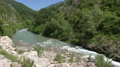 Verdon river in canyon, road traffic in distance  hold + pan Stock Footage