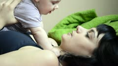 Young mother plays and talks to the baby Stock Footage