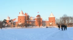 Winter sunset Trakai castle snow people tourists active beauty Stock Footage
