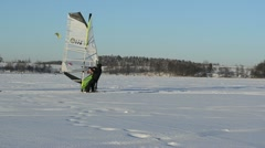 People ice sailing surfing kiteboard winter Galves lake Trakai Stock Footage