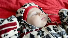 Baby sleeps in the street warm clothing Stock Footage