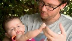 Dad Holds and Kisses his Baby Girl Stock Footage
