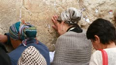 weman pray at western wall Jerusalem - stock footage