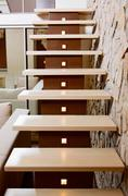 Modern style staircase and ashlar wall, interior detail Stock Photos