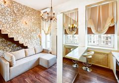 modern style living-room interior with staircase and ashlar wall - stock photo
