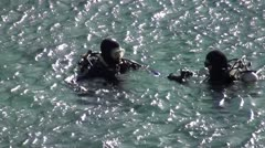 Divers floating before dive 2 - stock footage
