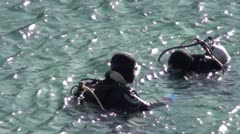 Divers floating before dive - stock footage