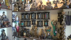 Tibetan buddhist souvenirs and objects in Dharamsala shop, India Stock Footage