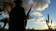 Man Guards Land With Rifle Stock Footage