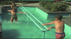 Vintage 8 mm film: Children plunge in Kneipp pool, 1970s Stock Footage