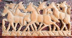 Beautiful sculpture of horse made of only one peace of wood Stock Photos